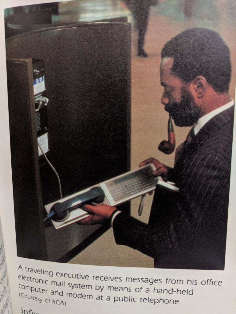 A traveling executive receives messages from his office electronic mail system by means of a hand-held computer and modem at a public telephone.